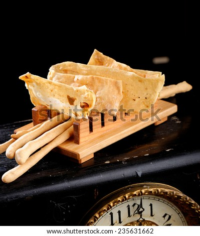 Fine dining Italian appetizers, Grissini bread sticks and crackers with salt - stock photo