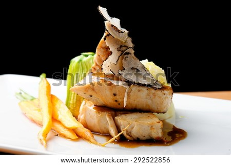 Fine dining main course, grilled chicken breast with black truffles, quiche and potato puree - stock photo