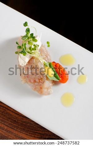Fine dining, una fish tartare taco - stock photo