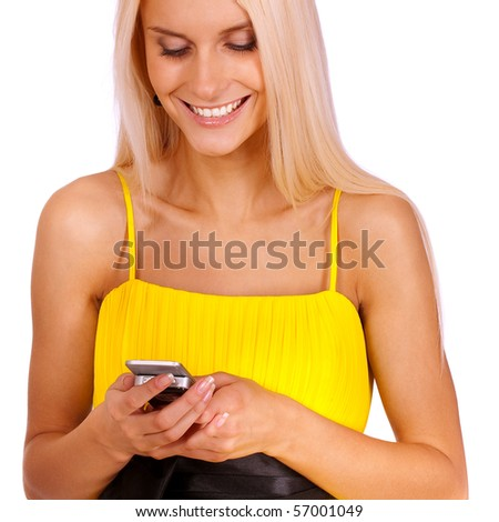 Fine girl in yellow dress with mobile phone, it is isolated on white background. - stock photo