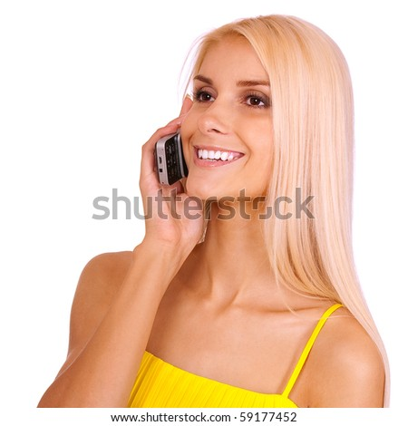 Fine girl in yellow dress with mobile phone, it is isolated on white background.