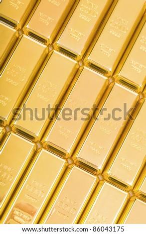 Fine gold 999,9. Set of gold ingots. - stock photo