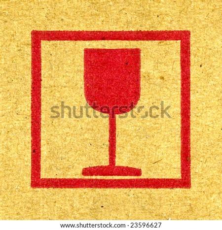 Fine image close-up of red fragile symbol on cardboard - stock photo