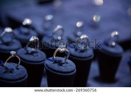 Fine luxury diamond jewellery window display with ring  pedant - stock photo