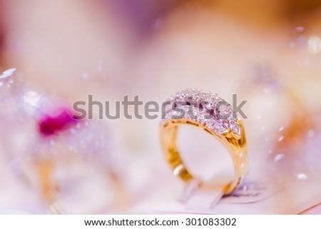 Fine luxury diamond jewellery window display with ring pedant - stock photo