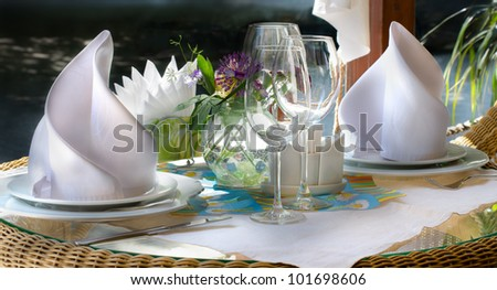 Fine table setting in gourmet restaurant/Table Setting - stock photo