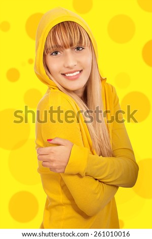 Fine young woman in yellow jacket, it is on yellow background. - stock photo