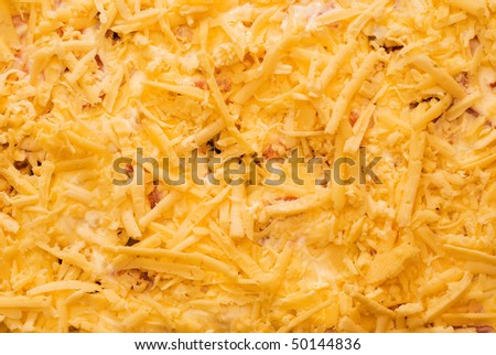 finely grated cheese, texture, yellow - stock photo