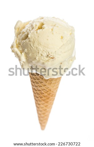 finest macademia ice cream scoop filled in an ice cream cone isolated on white background - stock photo