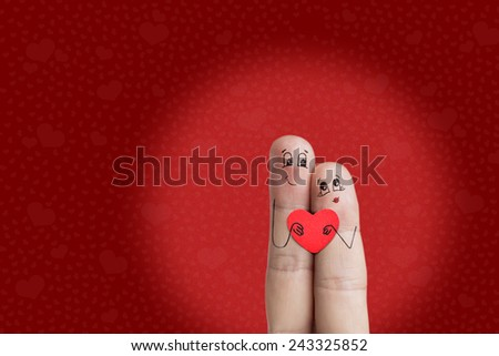 Finger art. Lovers is embracing and holding red heart. There are path included in image. You can easily cut out fingers from the background. And insert them into a different scene from this series - stock photo
