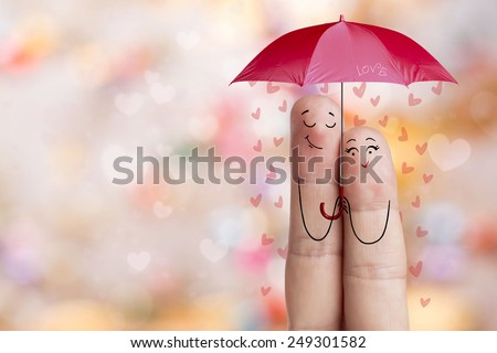 Finger art. Lovers is embracing and holding red umbrella. Stock Image. Happy Valentine's Day and 8 March creative love series. Day Valentines Painted fingers in love  - stock photo