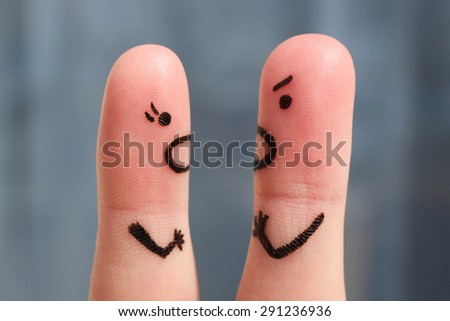 Finger art of a couple during quarrel. The concept of a man and woman yelling at each other. - stock photo