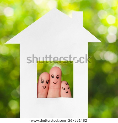 Finger art of a family. Family looking out of the window of the house out of paper. - stock photo