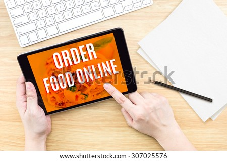 Finger click screen with Order food online word with keyboard on wooden table,Food business design concept - stock photo