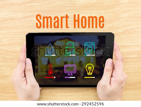 Finger click screen with Smart home application interface with keyboard on wooden table,Internet Business concept - stock photo