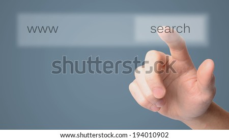 Finger clicking a search button  - stock photo
