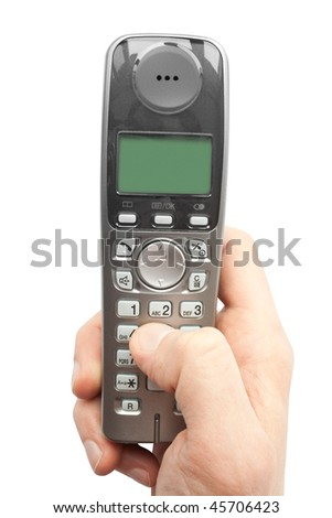 finger dials a phone number on a cordless telephone - stock photo