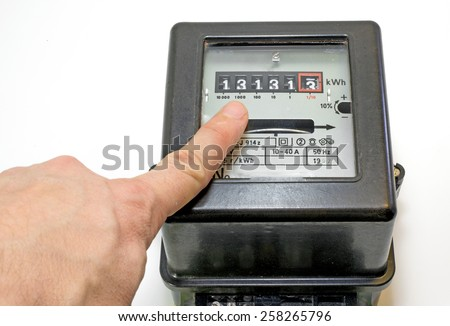 finger indicating the number on the counter of electricity - stock photo