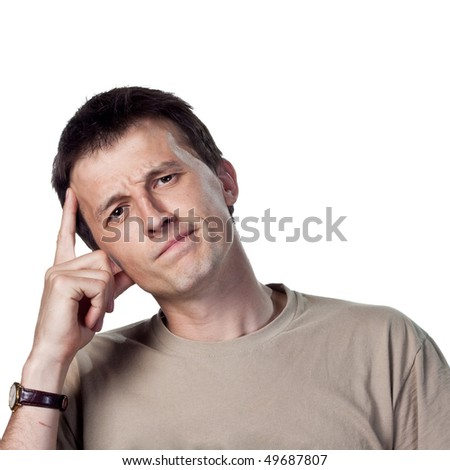 finger on forehead, thinking hard - stock photo