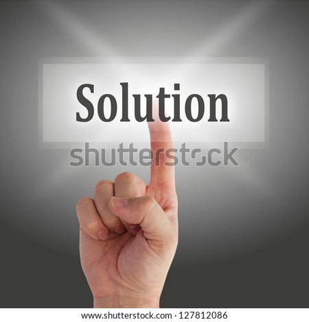 finger on solution button - stock photo