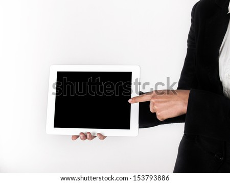 finger on the touch screen shows - stock photo