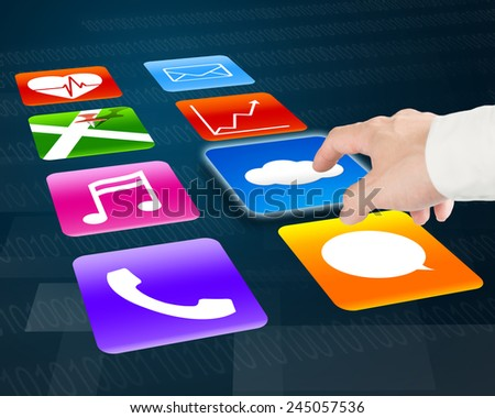 Finger pointing at cloud computing with colorful app icons on tech background - stock photo