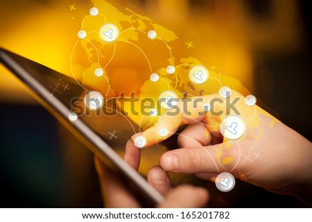 Finger pointing on tablet pc, social network concept - stock photo