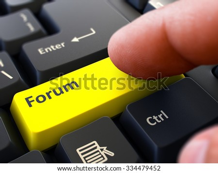 Finger Presses Yellow Button  Forum on Black Keyboard Background. Closeup View. Selective Focus. - stock photo