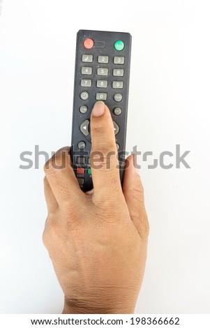 finger pressing a remote control - stock photo