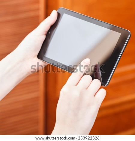finger pressing tablet pc screen in office - stock photo