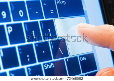 finger push enter on touch screen virtual keyboard - stock photo