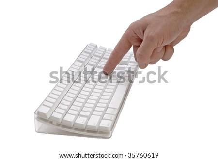 Finger pushing a key on keyboard - stock photo