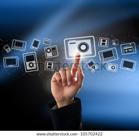 Finger pushing button on a multimedia touch screen interface - stock photo