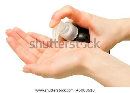 Finger pushing soap dispenser isolated on white background - stock photo