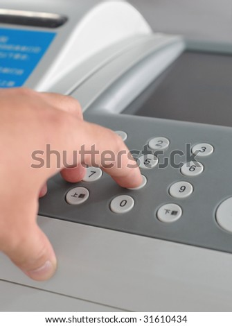 finger pushing the Fax
