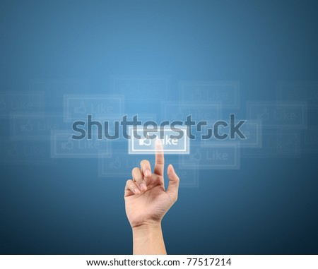 finger pushing the like button for social network concept - stock photo