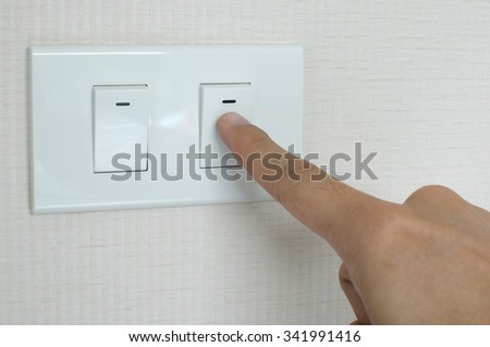 Finger switching light power switch on or off on wall