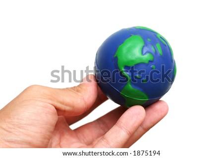 Finger tips holding globe of the earth over white - stock photo