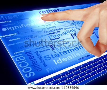 Finger touching a blue computer screen with word on it