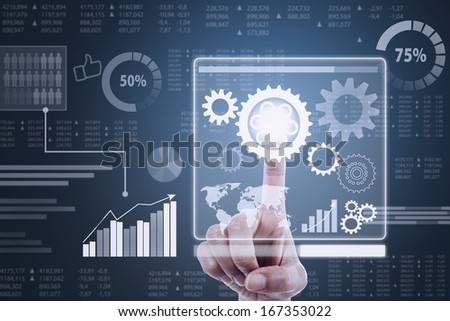 Finger touching screen with cogwheels on a futuristic interface - stock photo