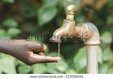 Finger Under Water Tap (Water Scarcity Symbol in Africa) - stock photo