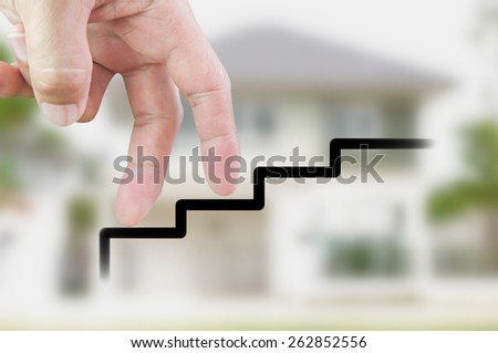 Finger walk up and blur house background - stock photo