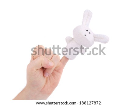 Finger wearing puppet rabbit. Isolated on a white background