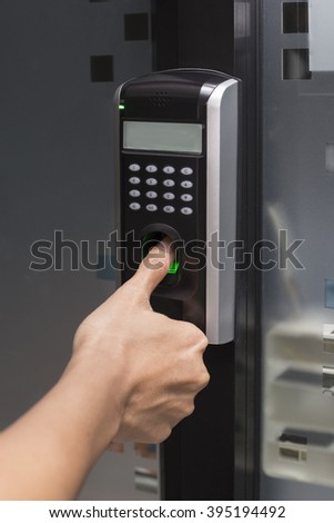 fingerprint and password lock in a office building - stock photo