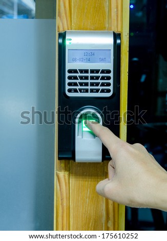 Fingerprint used as an identification method on a door lock - stock photo