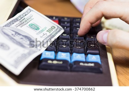 Fingers consider on the calculator - stock photo