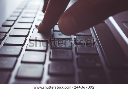 fingers digit on computer keyboard. concept about technology and communication - stock photo