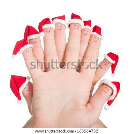 Fingers faces in Santa hats isolated on white background. Happy family celebrating concept for Christmas day. - stock photo