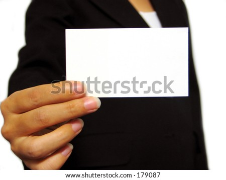 fingers holding a blank business card - stock photo