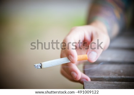 Fingers holding a cigarette